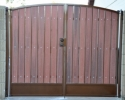 Simple arched RV gate with kickplate using our rust polyurethane paint and the rustic cedar composite privacy slats