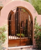 Arched double courtyard entry gate