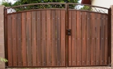 decorative, arched driveway gate with composite privacy slats