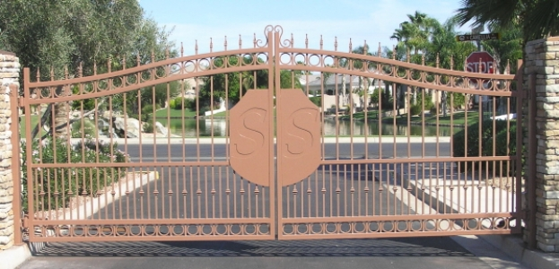 gated community entrance with the logo on the gates