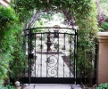 arched courtyard entry gate & panels with perforated steel backing