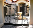 entryway with this beautiful arched gate and fixed panels
