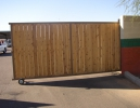 a rolling driveway gate with white cedar wood privacy slats