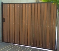 driveway gate with redwood composite privacy slats