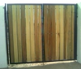 an 8 foot tall driveway gate using clear-coated poplar