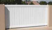 a sliding driveway gate with PVC pickets