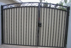 decorative arched gates with plate steel privacy panels