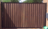 single swing driveway gate with rustic cedar composite privacy s
